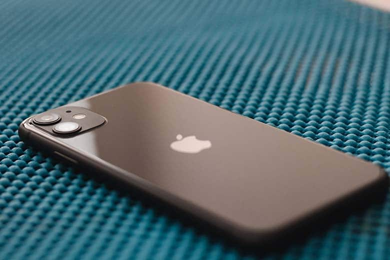 Black iPhone 11 on rubber mat