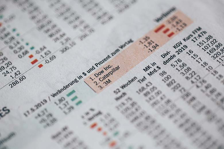 newspaper with stock exchange charts
