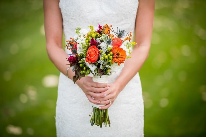 Lady in wedding dress with flower bouquet