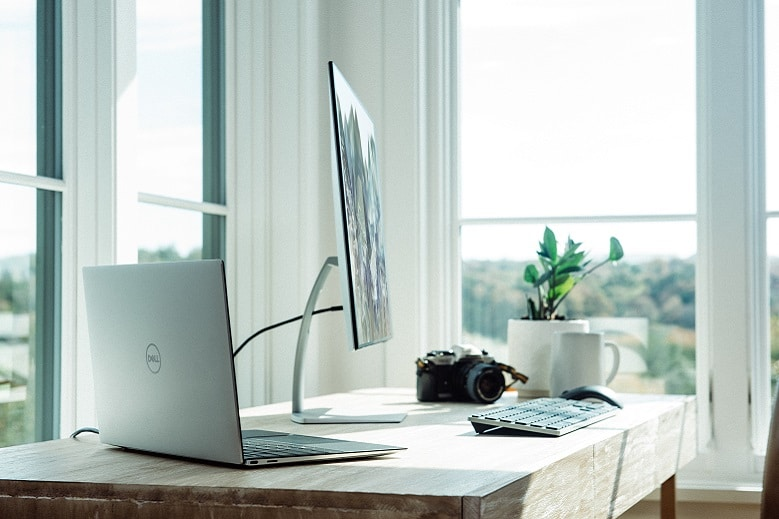 Dell XPS laptop and monitor on desk